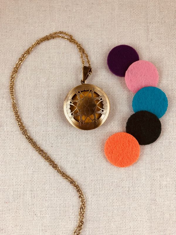 Collier diffuseur coeur d'or